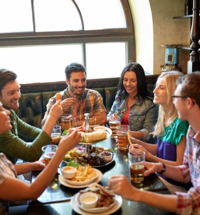 Group eating and drinking in restaurant