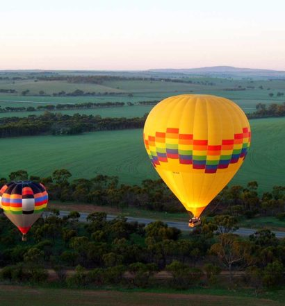 2 Hot Air Balloons In Flight
