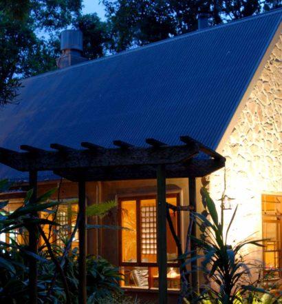 Luxury cottage brightly lit at night