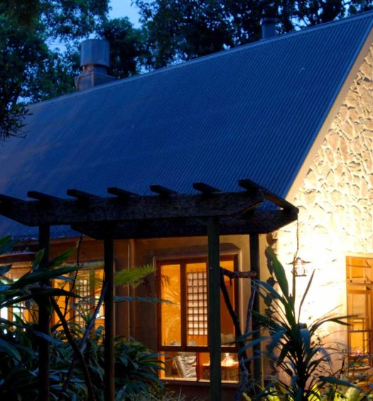 Luxury cottage brightly lit at night