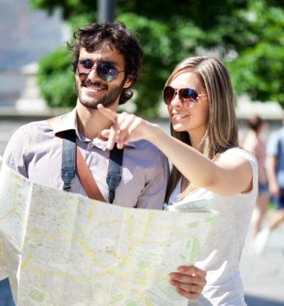 Couple reading a map getting out and about on Tamborine Mountain