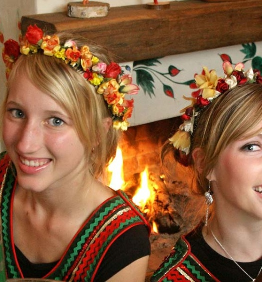two waitresses in traditional Polish costumes