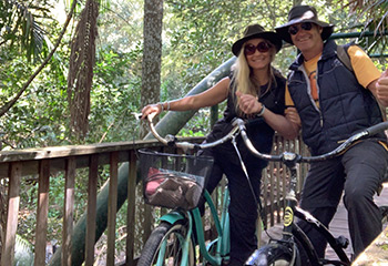 Two guests exploring Witches Cycling Trail on Tamborine Mountain